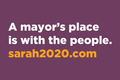 A Mayor's Place Window Sign